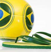 Flip flops and soccer ball with Brazil flag