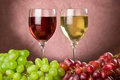 Red And White Wine With Red And Green Grapes