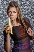 Beautiful Woman Eating Banana