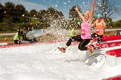 Women Get Sprayed With Bubbles Jumping Into Foam Pit