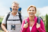 Portrait Of Mature Couple Smiling With Backpack