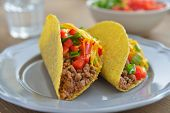 Tacos with ground beef, Cheddar cheese, and vegetables