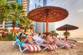 Couple on sun holidays at the Persian Gulf, Abu Dhabi