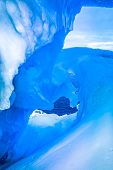 picture of flood-lights  - blue ice cave covered with snow and flooded with light - JPG