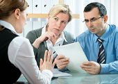 picture of business meetings  - mid adult couple meeting with financial planner or advisor - JPG