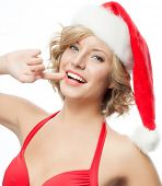 portrait of attractive caucasian smiling woman isolated on white. studio shot in santa's hat