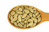 pic of cardamom  - Green cardamom in wooden spoon isolated on white - JPG
