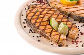 Close up of steak on wood platter.
