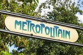 Art-deco Street Sign At The Entrance To The Paris Metro