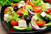 Greek salad in a black plate