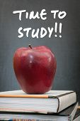 pic of time study  - Apple on books and time to study handwritten on the chalkboard in the background - JPG