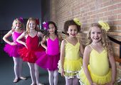 Cute young ballerinas at a dance studio (diverse group of girls)