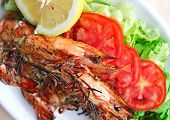 Fresh Grilled Shrimps With Tomatoes, Green Salad And Lemon