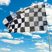 Race Flag With Blue Sky And Clouds On Background