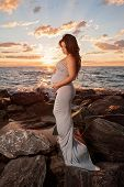Beach Maternity Portrait With Sunflare