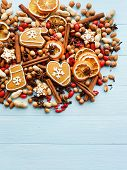 stock photo of christmas spices  - Christmas background nuts dried oranges spices and gingerbread cookies - JPG