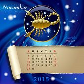 picture of scorpio  - Simple monthly page of 2015 Calendar with gold zodiacal sign against the blue star space background - JPG