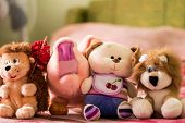 Different soft toys for children on the couch