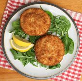 Cod fishcakes served with a rocket, spinach and watercress salad.