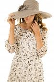 Woman Birds On Dress Pull Hat Over Eyes