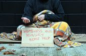 picture of scourge  - Homeless man holds out hand - JPG