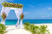stock photo of cabana  - wedding arch and set up on beach - JPG