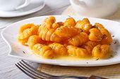 Pumpkin Gnocchi Closeup On A White Plate