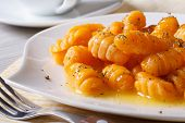 image of sagebrush  - Delicious pumpkin gnocchi with butter and spices on the plate closeup - JPG