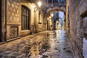 image of gothic  - Narrow street Carrer del Bisbe in gothic quarter Barcelona Spain - JPG