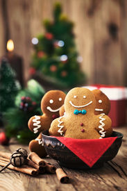 image of gingerbread man  - Christmas food. Gingerbread man cookies in Christmas setting. Xmas dessert