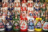 pic of dress-making  - Traditional handmade toys puppets dolls in symbolic artistic dress