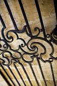 image of stone house  - Wrought iron gate of an old French stoned house - JPG