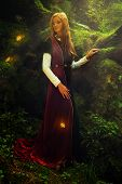 foto of fairies  - A beautiful woman fairy with long blonde hair in a historical gown is turning her head just to have a glimpse of shining golden butterflies flying around her in the deep woods - JPG