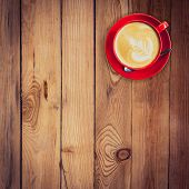 pic of latte  - red cup and latte coffee on wood table with space - JPG