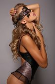 stock photo of lace  - fashion studio photo of beautiful sensual girl in lingerie corset with long blond hair with lace veil on face - JPG