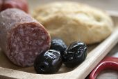 Постер, плакат: Appetizer With Small Salami And Olives