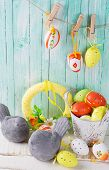foto of bird egg  - Colorful easter eggs and birds on wooden background - JPG