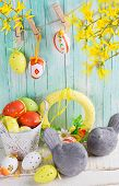 image of bird egg  - Colorful easter eggs and birds on wooden background - JPG