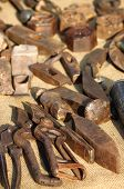 picture of workbench  - Tools of a blacksmith in a workbench - JPG