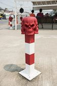 stock photo of bollard  - Skull Conceptual sculpture  - JPG