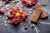 image of tartar  - Beef tartare with fresh toasts on dark marble background - JPG