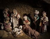 picture of bethlehem  - The baby Jesus lies in a manger watched over by his mother Mary her husband Joseph a lowly shepherd the three wise men and animals in the stable at Bethlehem - JPG