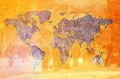 image of earth structure  - World Population Concept Earth shaped crack in Yellow wall and silhouettes of people - JPG