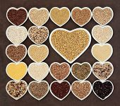 pic of whole-wheat  - Grain and cereal food selection in heart shaped porcelain bowls over lokta paper background - JPG