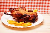 foto of roast duck  - Roast duck with oranges on wooden table - JPG