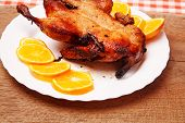 picture of roast duck  - Roast duck with oranges on wooden table - JPG