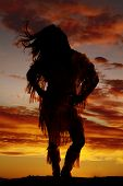 foto of apache  - a silhouette of a woman in her Indian clothing with the wind blowing her hair - JPG
