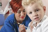 image of flu shot  - A Small boy with as nurse gives him a shot - JPG
