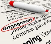 pic of empower  - Engagement word circled in a dictionary definition to illustrate meaning of the word in business attracting customers with involvement and participation - JPG