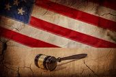 foto of proceed  - Gavel on a background of the American flag - JPG